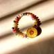 دستبند گل زرد و مهره رنگی